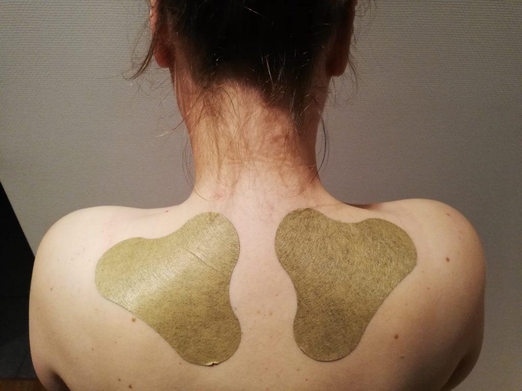 Wärmepflaster auf dem Rücken