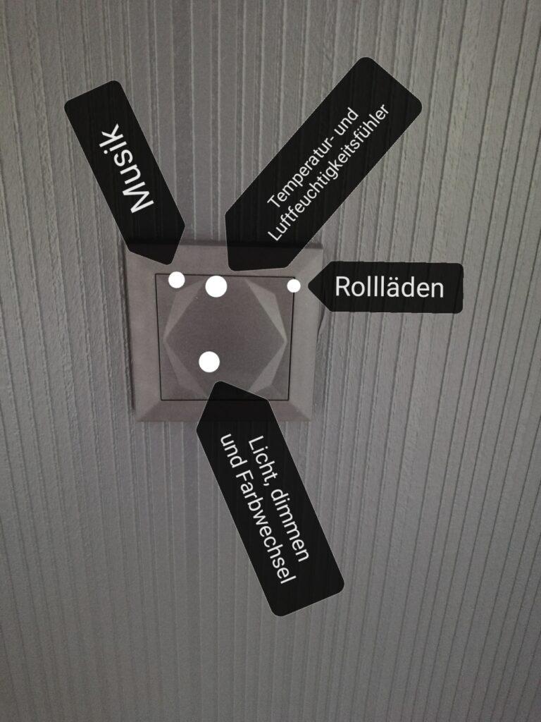 Ein Loxone Touch: Er hat 5 frei Programmierbare Schaltpunkte und kann die Temperatur und Luftfeuchtigkeit messen
